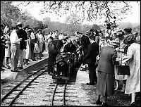 BNPS.co.uk (01202 558833)<br /> Pic:  BraybrookCollection/BNPS<br /> <br /> The opening of the railway with Sterling Moss in 1964.<br /> <br /> A late aristocrat's prized collection of model trains has sold for £244,000.<br /> <br /> Lord Braybrooke set up a miniature garden railway 55 years ago in the grounds of his stately home at Audley End House in Saffron Walden, Essex.<br /> <br /> He died in 2017 and his family parted with nine of his locomotives to raise funds to improve the railway's facilities so it can keep running for future generations.