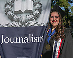 Nicole Skow stands with the Journalism banner during the University of Nevada College of Liberal Arts and Donald W. Reynolds School of Journalism graduation ceremony on Saturday morning, May 20, 2017.