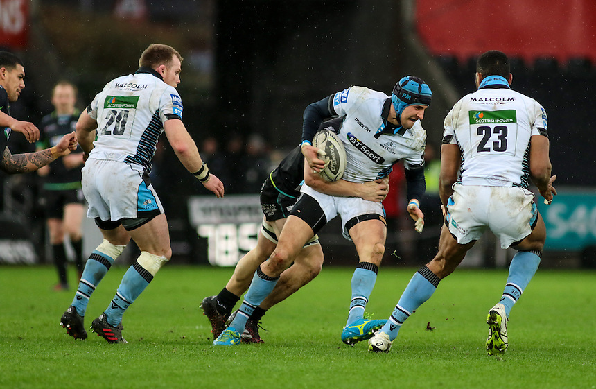 Glasgow Warriors' Peter Murchie is tackled in midfield. Ratu Tagive (23) and Chris Fusaro (20) are in support.<br /> <br /> Photographer /Dan MintoCameraSport<br /> <br /> Guinness PRO12 Round 16  - Ospreys v Glasgow Warriors - Sunday 26th February 2017 - Liberty Stadium - Swansea<br /> <br /> World Copyright &copy; 2017 CameraSport. All rights reserved. 43 Linden Ave. Countesthorpe. Leicester. England. LE8 5PG - Tel: +44 (0) 116 277 4147 - admin@camerasport.com - www.camerasport.com