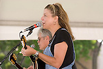 Lloyd Maines (left) and Terri Hendrix perform during the Arbor Daze festival in Euless, Texas