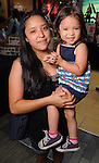 Geneva Castanon and Evie Balderas,2,at the M.D. Anderson Back-to-School Fashion Show at the Galleria Saturday Aug. 16, 2014.(Dave Rossman photo)