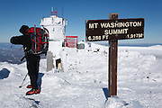 Hiker on the summit of Mount Washington during the winter months in the White Mountains, New Hampshire USA