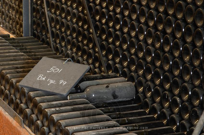 Piles of old bottles aging in the cellar, rouge red 1999 written on the chalk board Chateau Vannieres (Vannières) La Cadiere (Cadière) d'Azur Bandol Var Cote d'Azur France