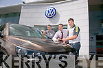 Divanes of Castleisland's Sam Divane, and John Vahey, presenting Castleisland Desmonds Manager  Eamon Fitzmaurice with a Volkswagen Tiguan on Tuesday