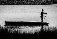 Harry Murray pilots his bateau boat in a creek near Hilton Head Island. The Gullah Geechee once relied heavily on the shallow-draft, flat-bottom boats for transportation and fishing. But few Gullah Geechee use the boats today, and almost no one in the community builds them anymore.