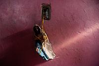 BOGOTA - COLOMBIA, 27-05-2020: Habitante de la comunidad salva de los desalojos masivos del 2 de Mayo, su máxima pertenencia: parte de una virgen de porcelana. Mas de 200 familias terminan el proceso de desalojo en el predio La Estancia al sur de Bogotá quedando sin ninguna ayuda ni un techo donde vivir durante la cuarentena total en el territorio colombiano causada por la pandemia  del Coronavirus, COVID-19. / Habitante de la comunidad salva de los desalojos masivos del 2 de Mayo, su máxima pertenencia: parte de una virgen de porcelana. More than 200 families are evicted from La Estancia farm at south of Bogota city and they left withoput any help and shelter to live during total quarantine in Colombian territory caused by the Coronavirus pandemic, COVID-19. Photo: VizzorImage / Mariano Vimos / Cont