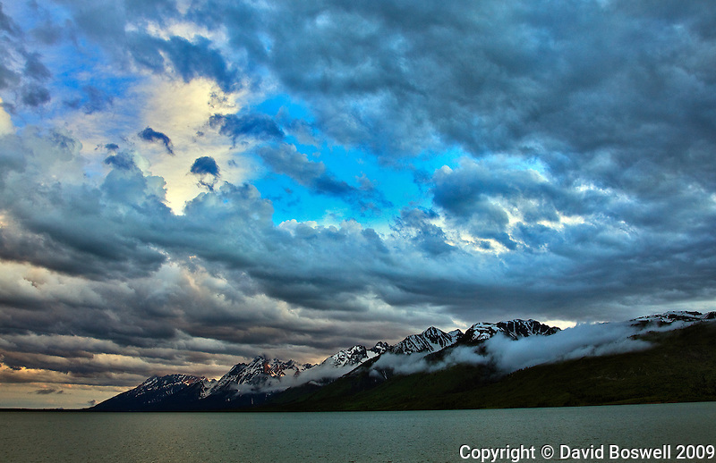 A summer storm provides late afternoon drama over Jackson Lake in Grand teton National Park.