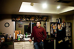 Derek Figg stands in his Tempe, Arizona home December 15, 2009. He stopped making mortgage payments in September. Mr. Figg bought the home in September 2007 and is moving out Sunday. CREDIT: Kendrick Brinson/Luceo Images for The Wall Street Journal