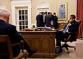United States President Barack Obama talks on the phone with President Hosni Mubarak of Egypt in the Oval Office,  Friday, January 28, 2011.   U.S. Vice President Joe Biden, left, and the President's National Security team listen in the background.  .Mandatory Credit: Pete Souza - White House via CNP
