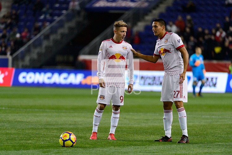 Harrison, NJ - Thursday March 01, 2018: Marc Rzatkowski, Sean Davis. The New York Red Bulls defeated C.D. Olimpia 2-0 (3-1 on aggregate) during a 2018 CONCACAF Champions League Round of 16 match at Red Bull Arena.