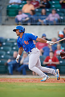 Midland RockHounds shortstop Richie Martin (12) follows through on a swing during a game against the Arkansas Travelers on May 25, 2017 at Dickey-Stephens Park in Little Rock, Arkansas.  Midland defeated Arkansas 8-1.  (Mike Janes/Four Seam Images)