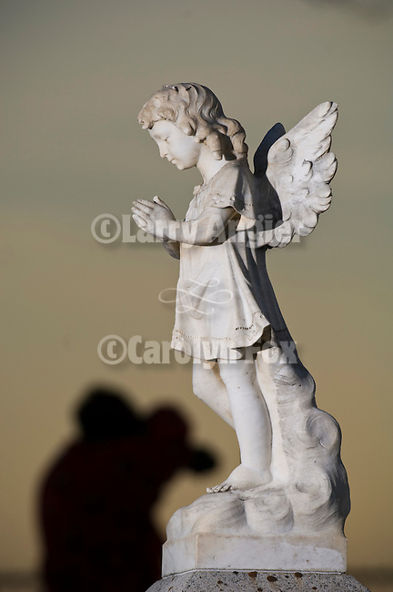 Angel statue headstones in cemetery, late on a winter day, Paradise Valley, Nev.