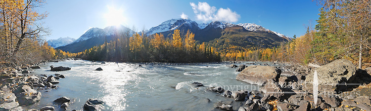 Bright sun, golden leaves and a fresh dusting of snow on the mountains make for a perfect fall day along Eagle River, near Anchorage, Alaska.