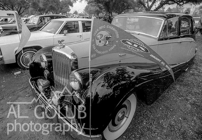 A Bentley with NFC Championship pennant in parking lot  at the Super Bowl XIX tailgate on the Stanford University campus. The San Francisco 49ers defeated the Miami Dolphins 38-16 on Sunday, January 20, 1985.  (AP Photo/Al Golub)