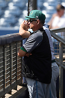 Daytona Tortugas pitching coach Tony Fossas (48) in the dugout during a game against the Charlotte Stone Crabs on April 14, 2015 at Charlotte Sports Park in Port Charlotte, Florida.  Charlotte defeated Daytona 2-0.  (Mike Janes/Four Seam Images)