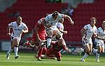 Guiness Pro12<br /> Ulster lock Franco Van Der Merwe hurdles past the diving tackle of Scarlets hooker Ken Owens<br /> Scarlets v Ulster<br /> Parc y Scarlets<br /> <br /> 06.09.14<br /> &copy;Steve Pope-SPORTINGWALES