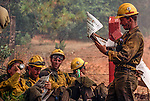 August 20, 1992 Angels Camp, California -- Old Gulch Fire—  Fulton Hotshots read the paper on Sheep Ranch Road. The Old Gulch Fire raged over some 18,000 acres, destroying 42 homes while threatening the Mother Lode communities of Murphys, Sheep Ranch, Avery and Forest Meadows.