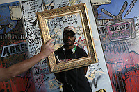 JOHANNESBURG, SOUTH AFRICA - JULY 18:  A local painter poses for a portrait in Johannesburg, South Africa.  (Photo by Landon Nordeman)
