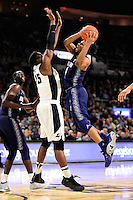 Wednesday, January 4, 2016: Georgetown Hoyas guard Jagan Mosely (4) works to get over Providence Friars forward Emmitt Holt (15) on his way to the basket during the NCAA basketball game between the Georgetown Hoyas and the Providence Friars held at the Dunkin Donuts Center, in Providence, Rhode Island. Providence defeats Georgetown 76-70 in regulation time. Eric Canha/CSM