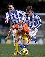 Real Sociedad's Markel Bergara (l) and Antoine Griezman (r) and FC Barcelona's Andres Iniesta during La Liga match.January 19,2013. (ALTERPHOTOS/Acero) /NortePhoto