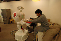 "The human symbiotic robot ""Twendy One"" that is being developed to aid in labor shortages and in aging societies. The 1.5 meter tall and 111 kg heavy robot is able to assist lift a human and also is dextrous enough to massage."