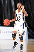 25 November 2011:  FIU guard Jerica Coley (22) handles the ball in the second half as the University of Maryland Terrapins defeated the FIU Golden Panthers, 84-52, at the U.S. Century Bank Arena in Miami, Florida.