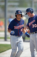 Minnesota Twins Travis Harrison (30) congratulates Shannon Wilkerson (45) after hitting a home run during a minor league Spring Training game against the Baltimore Orioles on March 16, 2016 at CenturyLink Sports Complex in Fort Myers, Florida.  (Mike Janes/Four Seam Images)