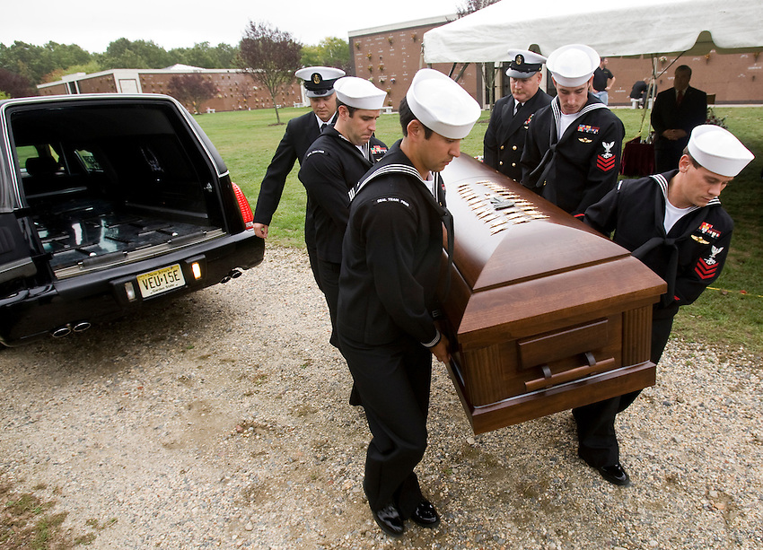 TOMS RIVER, N.J. -- US Navy Seals remove the casket carrying the remains of their fallen comrade, Denis Miranda, after his funeral at Ocean County Memorial Park. Miranda, 24, a Seal from Toms River, was killed in a helicopter crash in southern Afghanistan last week.  (9/30/2010)  photo by Andrew Mills/The Star-Ledger.. Sent DIRECT TO SELECTS Thursday, September 30, 2010 14:54:15 5466 3941