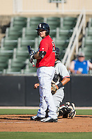 Ethan Gross (18) of the Kannapolis Intimidators checks with his thord base coach for the sign before stepping up to the plate against the Hickory Crawdads at CMC-Northeast Stadium on May 21, 2015 in Kannapolis, North Carolina.  The Intimidators defeated the Crawdads 2-0 in game one of a double-header.  (Brian Westerholt/Four Seam Images)