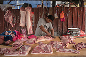 A butcher prepares cuts of meat for customers at a local wet market in Pandamaran in Klang, Selangor, Malaysia on October 16th, 2016. <br /> In September 1998, a virus among pig farmers (associated with a high mortality rate) was first reported in the state of Perak in Malaysia. Dr. Chua investigated and discovered the virus and it was later named, Nipah Virus. The outbreak in Malaysia was controlled through the culling of &gt;1 million pigs.