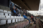 Edinburgh City v Spartans, 11/04/2015. Commonwealth Stadium, Scottish Lowland League. Spectators in the grandstand watching the second-half action at the Commonwealth Stadium at Meadowbank during the Scottish Lowland League match between Edinburgh City (white shirts) and city rivals Spartans, which was won by the hosts by 2-0. Edinburgh City were the 2014-15 league champions and progressed to a play-off to decide whether there would be a club promoted to the Scottish League for the first time in its history. The Commonwealth Stadium hosted Scottish League matches between 1974-95 when Meadowbank Thistle played there. Photo by Colin McPherson.