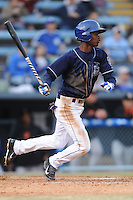 Asheville Tourists left fielder Raimel Tapia #15 swings at a pitch during a game against the Delmarva Shorebirds at McCormick Field on April 5, 2014 in Asheville, North Carolina. The Tourists defeated the Shorebirds 5-3. (Tony Farlow/Four Seam Images)