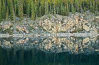 Rocky shoreline reflection in Horseshoe Lake<br /> Jasper National Park<br /> Alberta<br /> Canada
