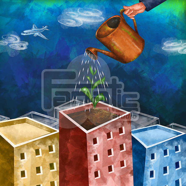 Human hand watering plant on building depicting growth of investment