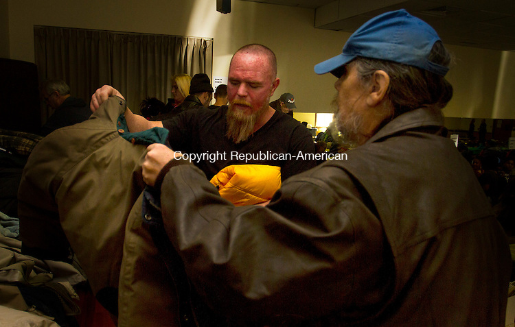 TORRINGTON, CT - 19 NOVEMBER 2016 - 111916JW05.jpg -- Volunteer Thomas Campbell helps Ron Chase find a jacket Saturday afternoon at the Knights of Columbus Hall during the coat drive sponsored  by FISH of Northwest Connecticut and the United Way of Northwest Connecticut.The drive is timed to help launch the National Hunger and Homeless Awareness Week.    Jonathan Wilcox Republican-American