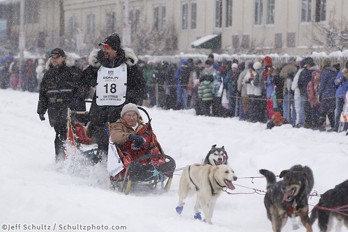Lance Mackey Saturday, March 3, 2012  Spectators take photos of Lance Mackey's team as it passes them by on Cordova street during the Ceremonial Start of Iditarod 2012 in Anchorage, Alaska.