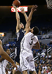 Utah State's David Collette (13) shoots over Nevada's AJ West (3) during an NCAA college basketball game in Reno, Nev., on Tuesday, Jan. 20, 2015. (AP Photo/Cathleen Allison)