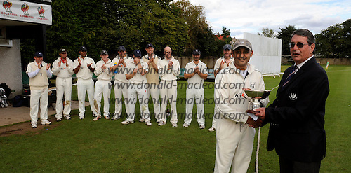 Scottish National Cricket League, Premier Div - Forfarshire V Grange at Forthill, Dundee - leading from the front Grange Capt Sanjay Patel (in tandem with batsman Ollie Hairs) batted his team to the 2010 Premier League title, here presented to him by Cricket Scotland Board member Jim McFadyen - Picture by Donald MacLeod - mobile 07702 319 738 - clanmacleod@btinternet.com - words if required from William Dick 077707 839 23