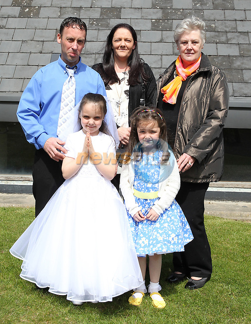 Lauren Kirk pictured on her big day with her family at Julianstown church.