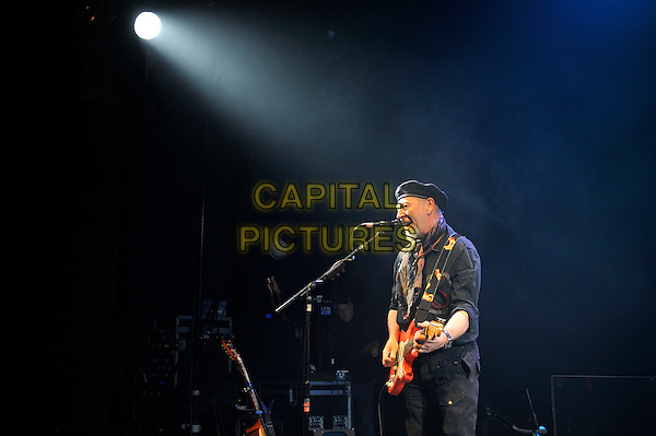 Richard Thompson.performing in concert, Shepherd's Bush Empire, London, England. .25th February 2013.on stage lie gig performance music side profile singing length half hat flat cap scarf black shirt trousers guitar goatee facial hair .CAP/MAR.© Martin Harris/Capital Pictures.