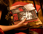 July 26, 2017. Raleigh, North Carolina.<br /> <br /> Many attendees bought copies of Alan Gratz's new book &quot;Refugee&quot; at the signing. <br /> <br /> Author Alan Gratz spoke about and signed his new book &quot;Refugee&quot; at Quail Ridge Books. The young adult fiction novel contrasts the stories of three refugees from different time periods, a Jewish boy in 1930's Germany , a Cuban girl in 1994 and a Syrian boy in 2015.
