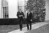 "United States President Gerald R. Ford, left, and US President-elect Jimmy Carter, right, walk together to meet reporters outside the Oval Office of the White House in Washington, D.C. following their discussions on the transition on November 22, 1976.  This is the first meeting between the two men since the Presidential debates during the campaign.<br /> Credit: Benjamin E. ""Gene"" Forte / CNP"