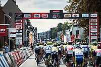 Peloton crossing the finish line during one of the 13 local laps<br /> <br /> Heistse Pijl 2020<br /> One Day Race: Heist-op-den-Berg > Heist-op-den-Berg 190km  (UCI 1.1)<br /> ©kramon