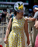 June 8, 2019 : A woman dresses up in all yellow on Belmont Stakes Festival Saturday at Belmont Park in Elmont, New York. Scott Serio/Eclipse Sportswire/CSM