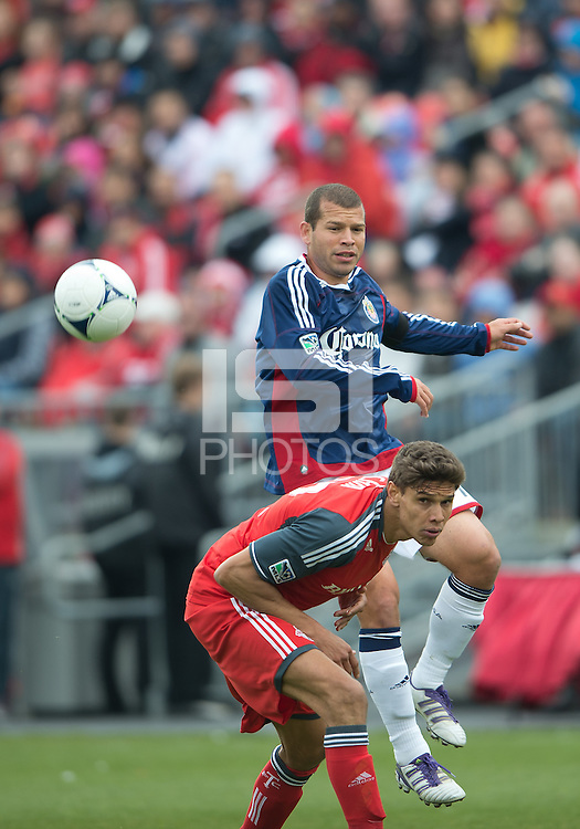 14 April 2012: Chivas USA forward Alejandro Moreno #15 and Toronto FC defender Adrian Cann #12in action during the first half in a game between Chivas USA and Toronto FC at BMO Field in Toronto.