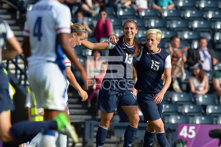 Glasgow, Scotland - July 25, 2012: Alex Morgan and Megan Rapinoe celebrate Morgan's second goal vs France.