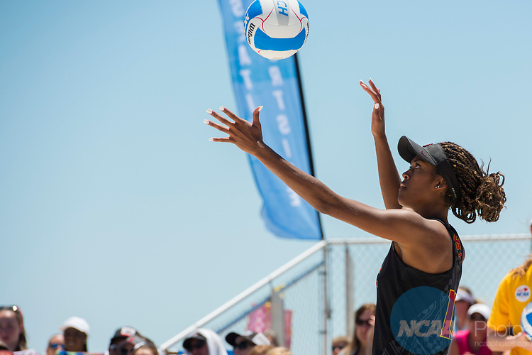 GULF SHORES, AL - MAY 07:  Joy Dennis (11) of the University of Southern California serves the ball during the Division I Women's Beach Volleyball Championship held at Gulf Place on May 7, 2017 in Gulf Shores, Alabama.The University of Southern California defeated Pepperdine 3-2 to claim the national championship. (Photo by Stephen Nowland/NCAA Photos via Getty Images)