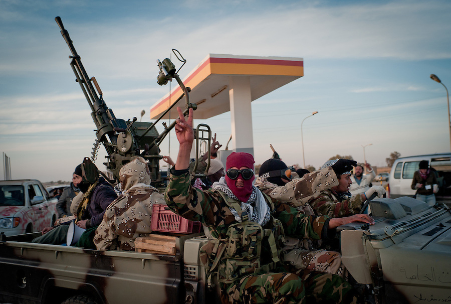 Rebels fill their truck at a petrol station between Ajdabiya and Benghazi.