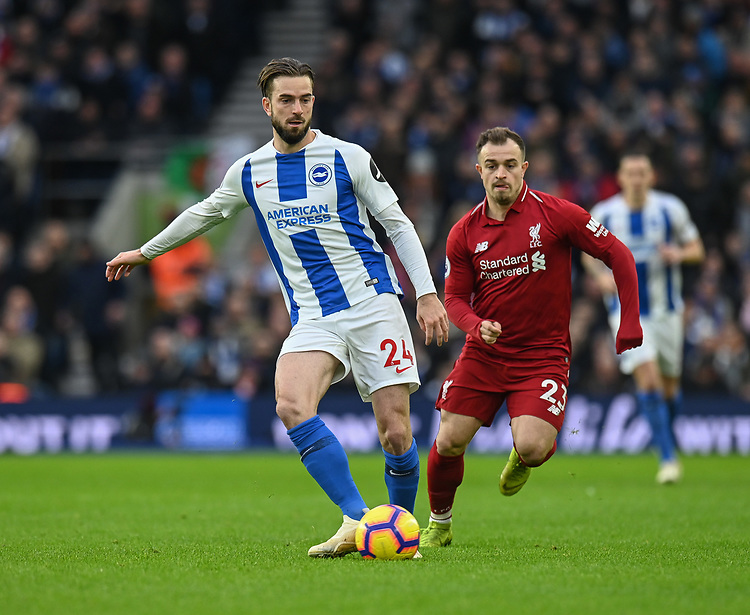 Brighton & Hove Albion's Davy Propper (left) under pressure from Liverpool's Xherdan Shaqiri (right) <br /> <br /> Photographer David Horton/CameraSport<br /> <br /> The Premier League - Brighton and Hove Albion v Liverpool - Saturday 12th January 2019 - The Amex Stadium - Brighton<br /> <br /> World Copyright © 2018 CameraSport. All rights reserved. 43 Linden Ave. Countesthorpe. Leicester. England. LE8 5PG - Tel: +44 (0) 116 277 4147 - admin@camerasport.com - www.camerasport.com