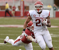 NWA Democrat-Gazette/ANDY SHUPE<br /> Arkansas running back Devwah Whaley (21) carries the ball Saturday, April 6, 2019, during the Razorbacks' spring game in Razorback Stadium in Fayetteville. Visit nwadg.com/photos to see more photographs from the game.